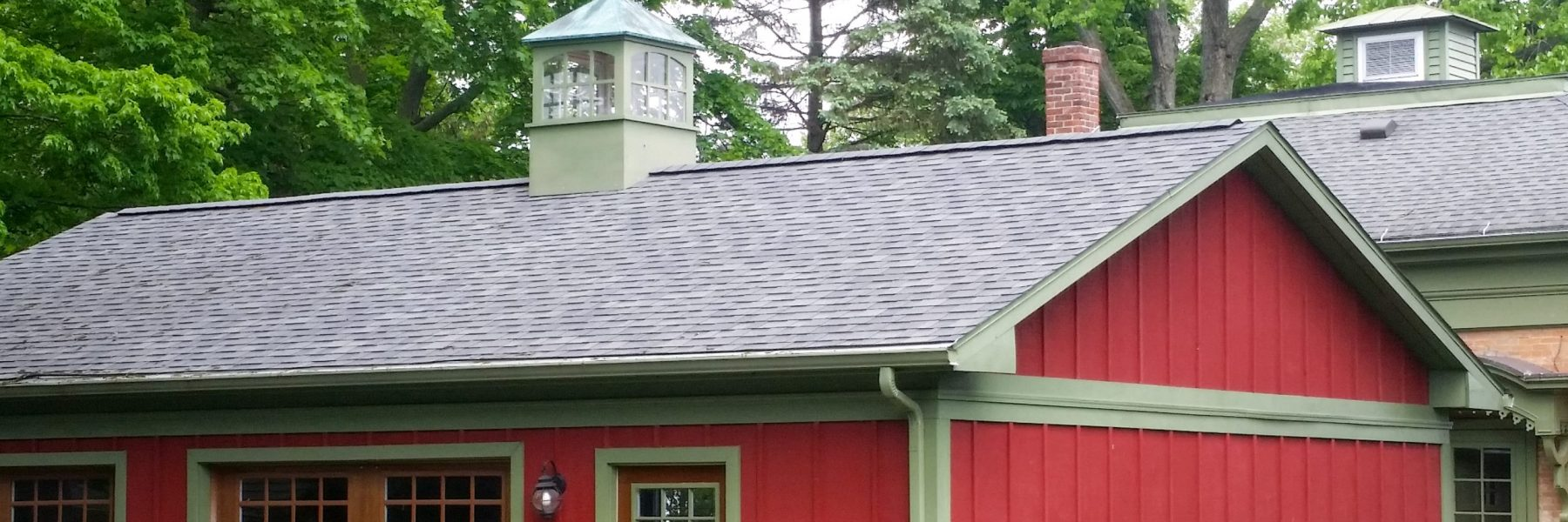 painted wooden cupola on two car garage